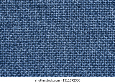 texture of rough fabric or textile material with a perepoleteniye closeup for a fashionable background or for wallpaper of princess blue color