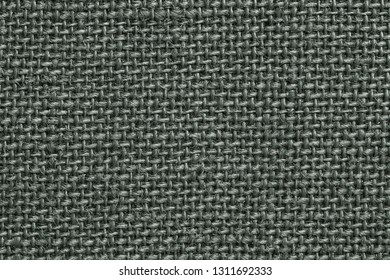 texture of rough fabric or textile material with a perepoleteniye closeup for a fashionable background or for wallpaper of four leaf clover color