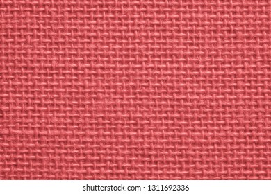 texture of rough fabric or textile material with a perepoleteniye closeup for a fashionable background or for wallpaper of fiesta coral color