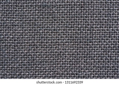 texture of rough fabric or textile material with a perepoleteniye closeup for a fashionable background or for wallpaper of graphite color