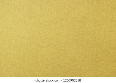 Texture of rough gold recycle paper sheet, abstract background