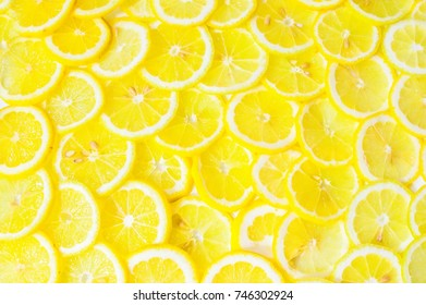 Texture from the rows of yellow round slices of lemon