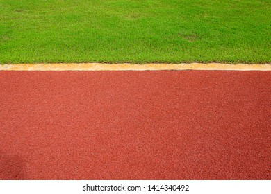 texture of running racetrack red rubber racetracks in outdoor stadium are 8 track and green grass field,empty athletics stadium with track,football field, soccer field.