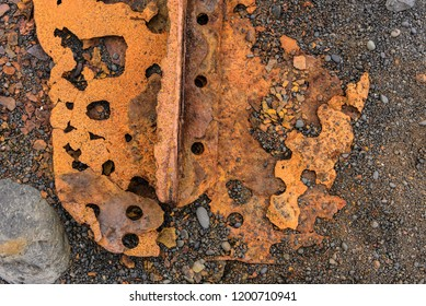 Texture of Rusty metal sitting on a rocky beach.Taken in Djupalonssandur Beach, Iceland