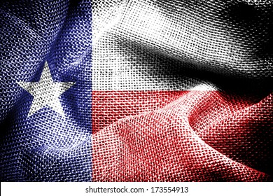 Texture of sackcloth with the image of the Texas Flag.