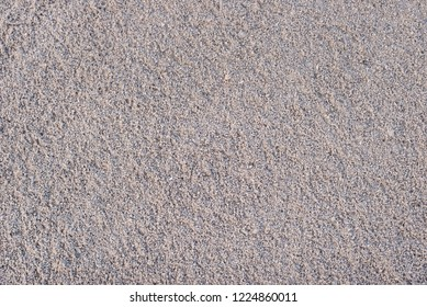 texture of sand and small pebble rocks in a construction area, top view