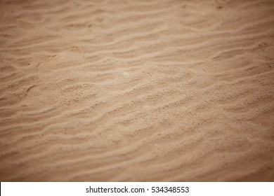 Texture of sand with small stones