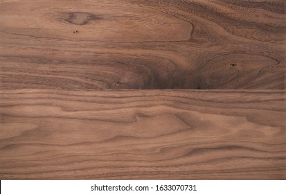 Texture of sanded raw black walnut wood without finish