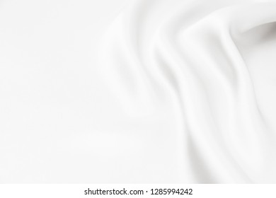 The texture of the satin fabric of white color for the background