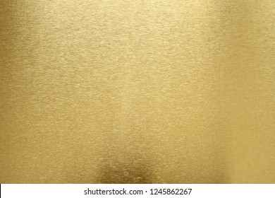Texture of shiny old gold bar, abstract background, selective focus