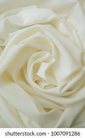 texture of silk fabric cream-coloured folded in the form of a rose