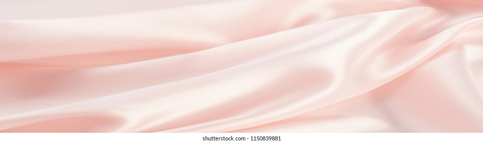 The texture of the silk fabric, soft pink.  rose-color, rose-colour, rose. Beautiful soft crumpled pink silk texture