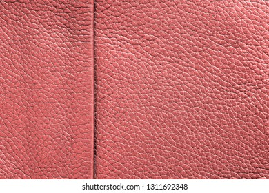 texture of skin or other leather material closeup for a background or for wallpaper of living coral color