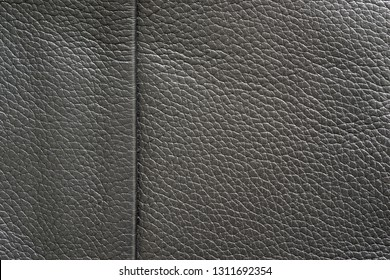texture of skin or other leather material closeup for a background or for wallpaper of black color