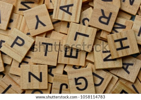texture of small wooden letters in a heap