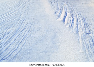 the texture of the snow surface without a trace of man