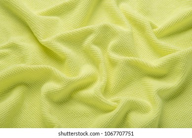 Texture of soft cotton fluffy yellow towel as a beautiful background