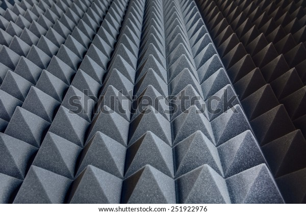 Texture soundproof panels in perspective. Triangles of the same shape of a special sound-absorbing polymer material gray. High-tech background.
