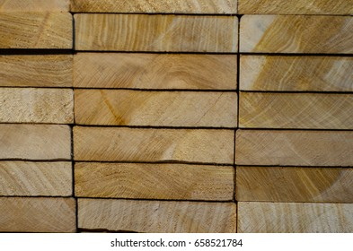 Texture of the stacked boards. Natural background