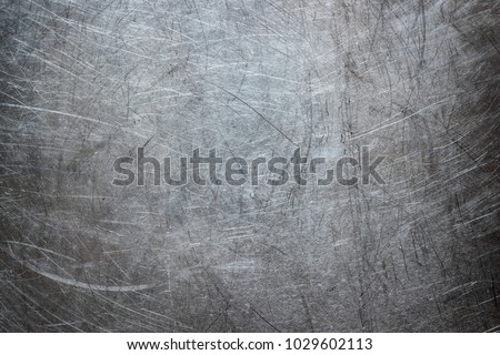 Texture of stainless steel wallpaper, background of metal with scuffs