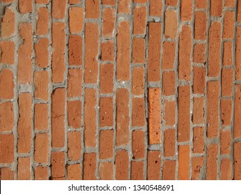 The texture of stone and brick paving and walls