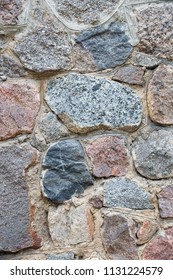 Texture of stone wall from large pieces of granite