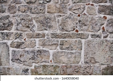 Texture of a stone wall. Old castle stone wall texture background. Stone wall as a background or texture. Part of a stone wall, for background or texture