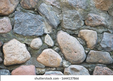 Texture of a stone wall. Old castle stone wall texture background. Stone wall as a background or texture. Part of a stone wall, for background or texture.