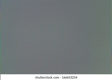 Texture of a surface of pixels of the liquid crystal monitor, closeup, for wallpaper and for an abstract background
