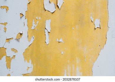 The texture surface of white and yellow color fade, peel off and crack wall damaged background