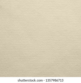 Texture of the surface of a yellowed sheet of ancient laid paper.  Laid paper 