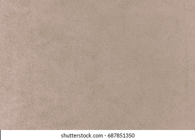The texture of the taupe velvet. The background of taupe cloth. Luxury background of taupe velvet