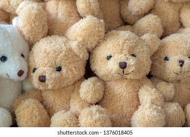 The texture of the teddy bear that is stacked together