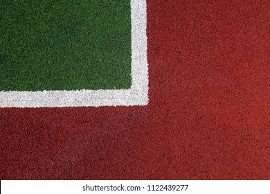 the texture of the tennis court, the intersection of lines and colors