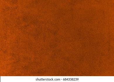 The texture of the terracotta velvet. The background of terracotta cloth. Luxury background of terracotta velvet