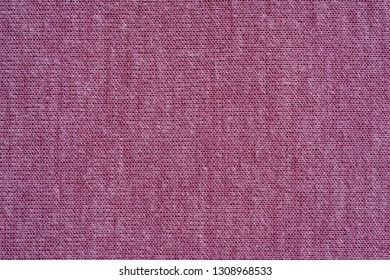 texture of textile material or jersey closeup for a monotonous background or for wallpaper of fashionable raspberry sorbet color