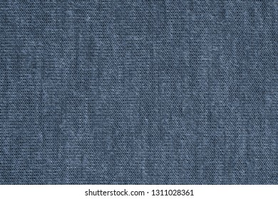 texture of textile material or jersey closeup for a monotonous background or for wallpaper of fashionable blue eclipse color