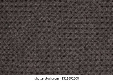 texture of textile material or jersey closeup for a monotonous background or for wallpaper of fashionable black morel color