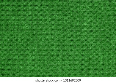 texture of textile material or jersey closeup for a monotonous background or for wallpaper of fashionable green color