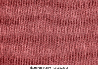 texture of textile material or jersey closeup for a monotonous background or for wallpaper of fashionable coral color