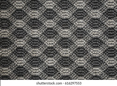 Texture of textile rug with pattern of white and gray colors