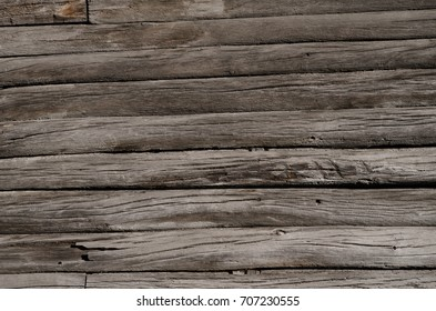 The texture, thin, rotten, old, gray, wooden boards are located one by one. Horizontal photo, wallpaper