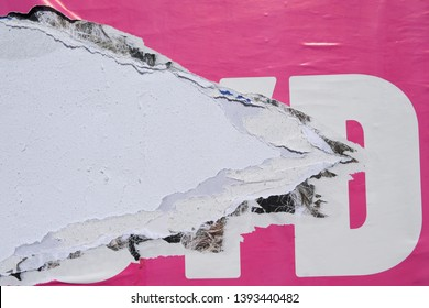 texture of a torn pink advertising bill poster close up