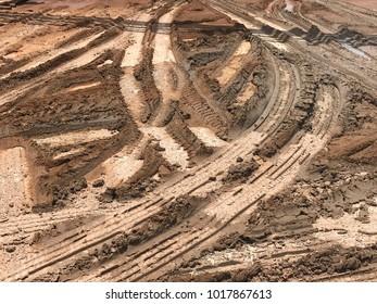 Texture of track wheel on dirt mud