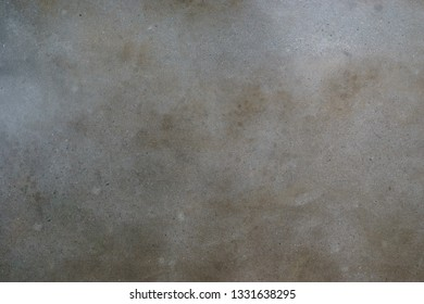 Texture of unsealed natural grey polished concrete.