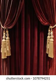 Texture of velvet fabric. Red velvet background curtains. Opera concept
