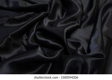 Texture of viscose fabric in gray. Background, pattern.