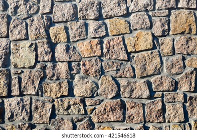 Texture of a wall built of granite stones
