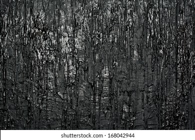 Texture a wall with flowing paint, black background