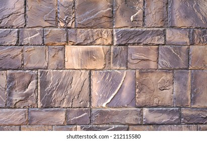 The texture of the wall of the great gray-brown polished stones